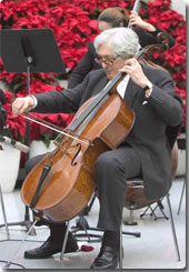 (Source: WorldBank.org James Wolfensohn performs with Bank/IMF Choral Group at Christmas Concert, 2004)