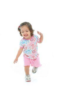 bigstockphoto_Little_Girl_Smiling_And_Dancin_592683