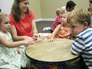 mom and child playing drums in Kindermusik