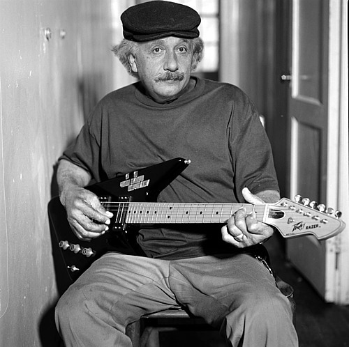 Einstein playing a guitar