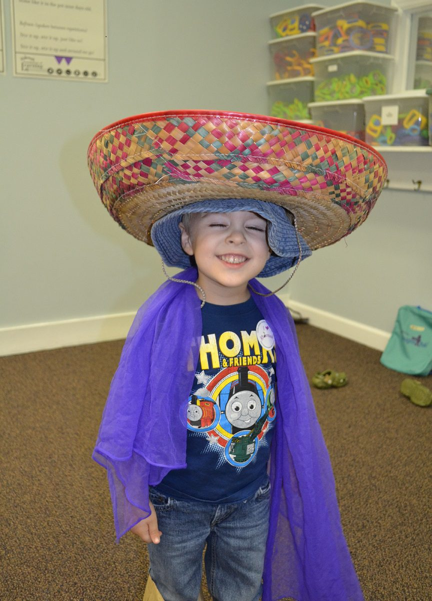 child playing dress up