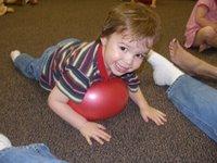 boy rolling on Gertie ball