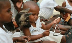 Kenyan child playing triangle