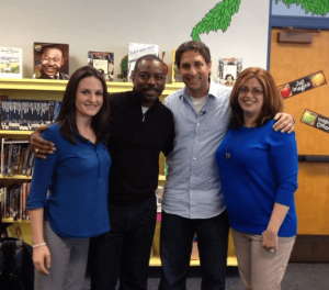 Kindermusik educator, Kelsey Springsted, and employee-owner, Jamie Sterling, with Reading Rainbow host LeVar Burton and CEO Mark Wolfe.