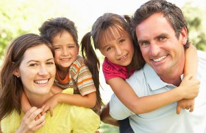 bigstock_Mother_And_Father_Giving_Child_13915643