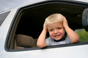 small toddler in car