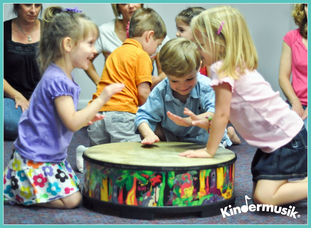 synchrony on the drums in Kindermusik class
