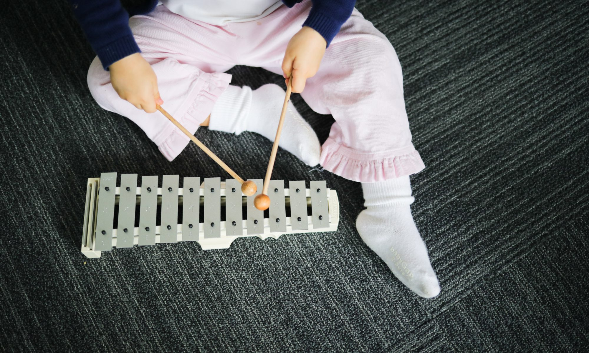 Kindermusik Class - Child with Glockenspiel