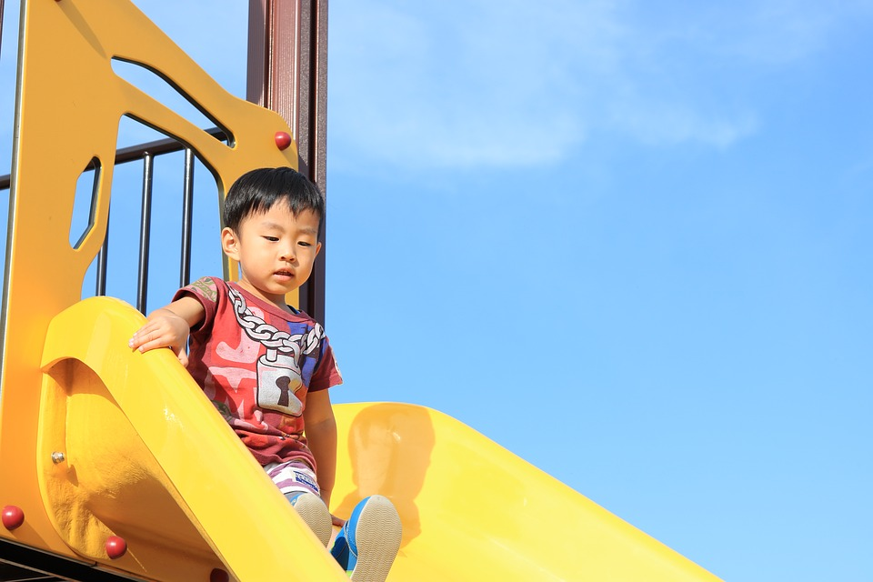 child on slide in summer