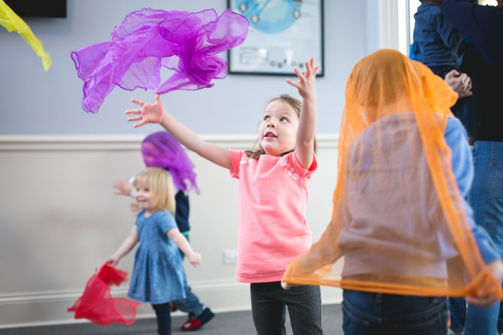 Kindermusik-Classroom-scarves-throwing-hiding-wearing-running