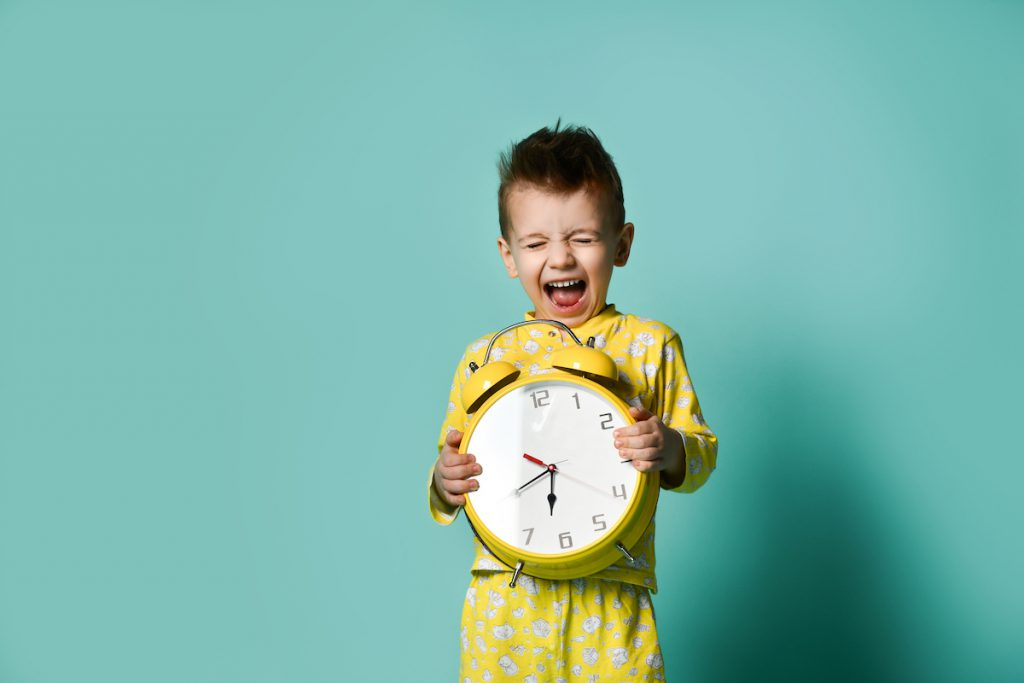 Young child holding clock - 5 Ways to Balance Work-from-Home AND Parent-from-Home