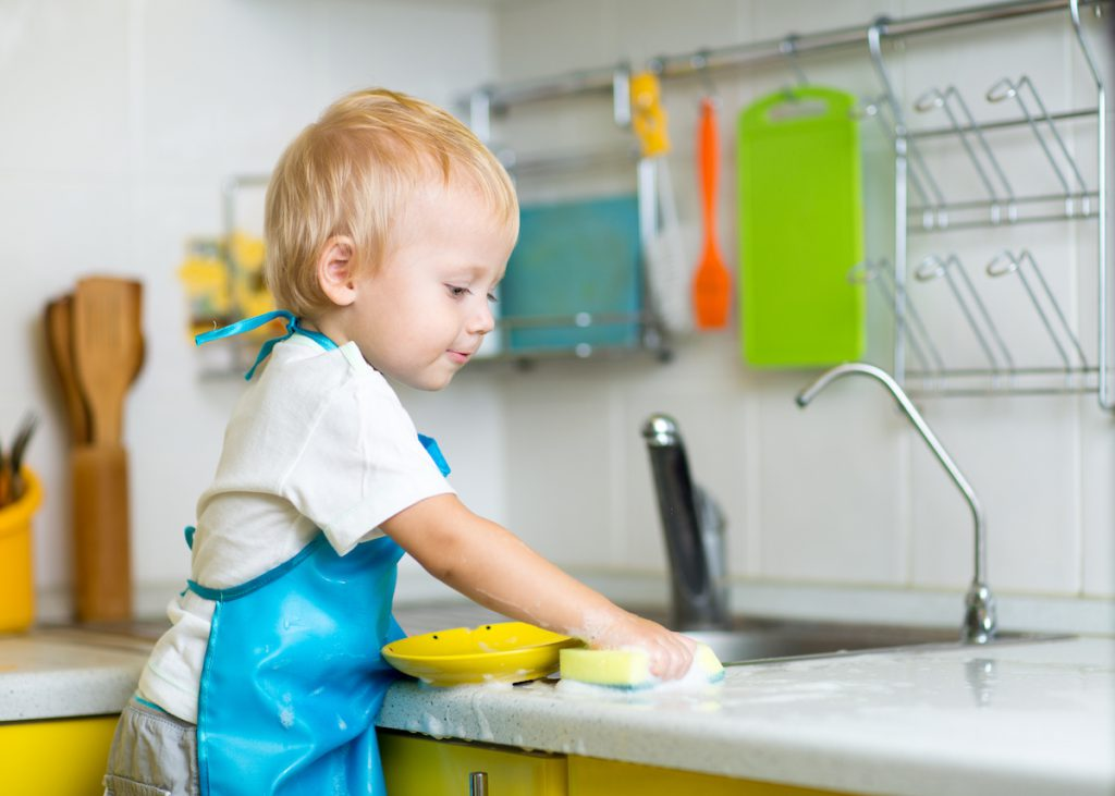 Young child washing dishes - 5 Ways to Balance Work-from-Home AND Parent-from-Home
